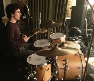 Simon Small drummer soundchecking, setting up for 70s thtemed party